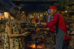 The Boma - guest being served at the braai area