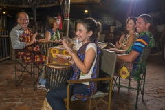 The Boma - guest enjoying the interactive drumming